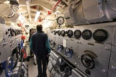 German submarine. LABOE, GERMANY - AUGUST 30, 2014: People visit German submarine U-995 (museum ship) in Laboe. It is the only surviving Type VII submarine in royalty free stock images