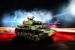 German tank on night road lit by bright light Royalty Free Stock Photo