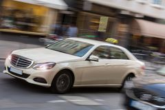 German taxi cab speeding in the city. A german taxi cab speeding in the city Royalty Free Stock Photo