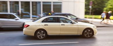 German taxi cab speeding in the city. A german taxi cab speeding in the city Stock Photo