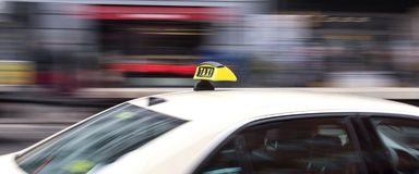 German taxi cab speeding in the city. A german taxi cab speeding in the city Stock Photos