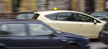 German taxi cab speeding in the city. A german taxi cab speeding in the city Stock Images