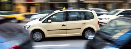 German taxi cab speeding in the city. A german taxi cab speeding in the city Stock Image