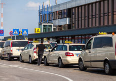 German taxi cars stands on airport. BERLIN / GERMANY - JUNE 4, 2016: german taxi cars stands on airport schoenefeld, berlin / germany at june 4, 2016 Royalty Free Stock Photography