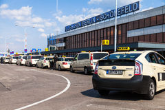 German taxi cars stands on airport. BERLIN / GERMANY - JUNE 4, 2016: german taxi cars stands on airport schoenefeld, berlin / germany at june 4, 2016 Royalty Free Stock Image