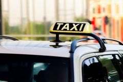 German Taxi sign. A closeup from a german taxi in movement at a sunny day Stock Photography