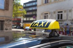 German taxi sign in an urban enviroment. A german taxi sign in an urban enviroment royalty free stock images