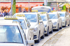 German Taxis. Tight crop of a row of cabs in germany with copy space - focus is on the first Taxi sign Royalty Free Stock Photography