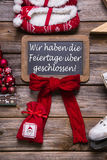 German text on a billboard: We have open on christmas holidays. Royalty Free Stock Photo