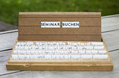 German text: Seminar buchen Stock Image