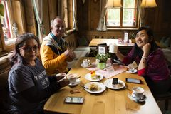 German and thai people travel sit and eating breakfast cake and Stock Image