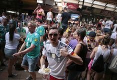 German Tourism in El Arenal Mallorca watching world soccer match on giant screen during their holidays stock photography