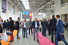 German trade show. Cologne, Germany - September 16, 2015 - Young business people rushing by on digital marketing exhibition and trade show Dmexco Royalty Free Stock Images