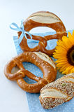 German traditional bread pretzels. Pretzels on a blue tablecloth with a sunflower Royalty Free Stock Images