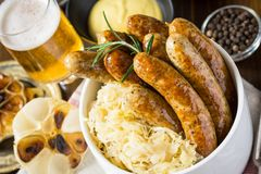 Traditional Grilled Sausages with Cabbage Salad, Mustard and Beer. German Traditional Grilled Sausages with Cabbage Salad, Mustard and Beer stock image