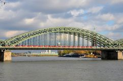 Train on bridge at Rhine River Cologne Germany Royalty Free Stock Image