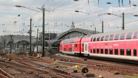 German train at Cologne railway station. Red german train driving into Cologne railway station in Germany stock footage