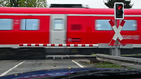 German train passing a railroad crossing in Thuringia, Germany stock video footage