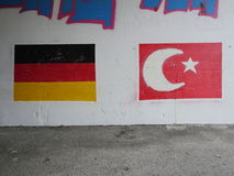 German Turkey Flag. Turkey and Germany flags on graffity walll royalty free stock images