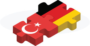 German and Turkish Flags in puzzle Royalty Free Stock Images