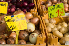 German vegetable market. Onion and potato with EUR prices on German vegetable market stock image