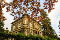 German villa in autumn scenery stock photography