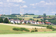 German village with houses, windmills and corn fields Stock Images