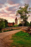 German village tower. A picturesque view of a bridge with a clock-tower in the backdrop, in Detwang, Germany stock images