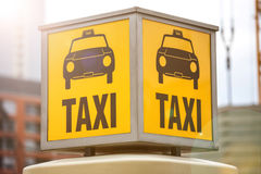 A german vintage taxi sign. A yellow german vintage taxi sign Stock Photo