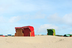 German wadden island Borkum. Beach of German wadden island with colorful wicker chairs stock photography