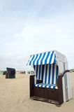 German wadden island Borkum. Beach of German wadden island with typical striped chair royalty free stock photography