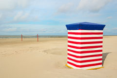 German wadden island Borkum. Beach of German wadden island with typical striped chair and volley ball net stock image