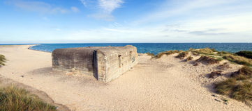 German war bunker on beach by sea Stock Image