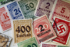 German War Stamps - High Inflation Overprinting. German postage stamps of the second world war showing overprinting with high values of thousands or millions of Stock Photography
