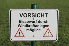 German warning sign. Warning sign in a German wind turbine park Stock Images