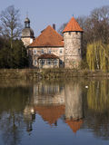 German water castle. In bright sunlight mirroring in the lake stock photos