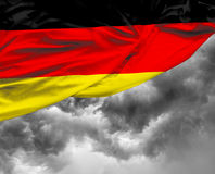 German waving flag on a bad day.  Royalty Free Stock Photo
