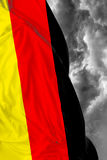 German waving flag on a bad day.  Stock Images