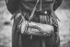 German Wehrmacht Infantry Soldier`s Military Equipment Of World. War II. Anti-gas Case Or Gas mask Storage On Soldier. Photo In Black And White Colors stock images