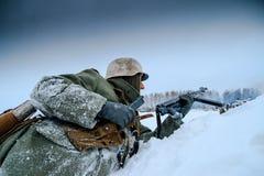 German Wehrmacht Soldier is reloading his submachine gun. Stock Photos