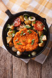 German Weiner schnitzel with vegetables in a pan. Vertical top v Stock Photography