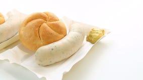 German white sausage with bun and mustard stock video footage