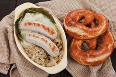 German white sausage with sauerkaraut Stock Photography