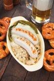 German white sausage with sauerkaraut Royalty Free Stock Photo