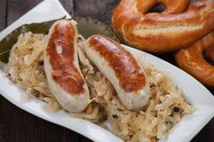 German white sausage with sauerkaraut Royalty Free Stock Image
