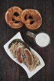 German white sausage with sauerkraut Royalty Free Stock Photo