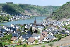 German wine village of Alken , Mosel valley, Eifel, Germany. German wine village of Alken an der Mosel located along the River Moselle with Romanesque church St Royalty Free Stock Photography