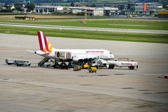 German Wings plane prepared for its next flight. A German Wings (Lufthansa) airplane A319-100 is prepared for its next flight at Stuttgart Airport Royalty Free Stock Photo