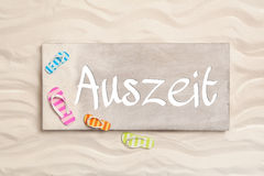 German word Auszeit what means time out. Summer holiday concept Stock Images