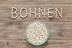 German word bohnen written with white beans royalty free stock photos